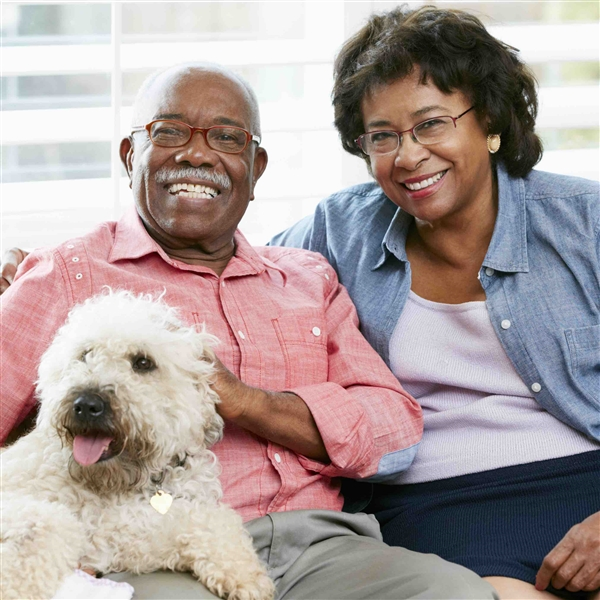 Couple smiling with their dog